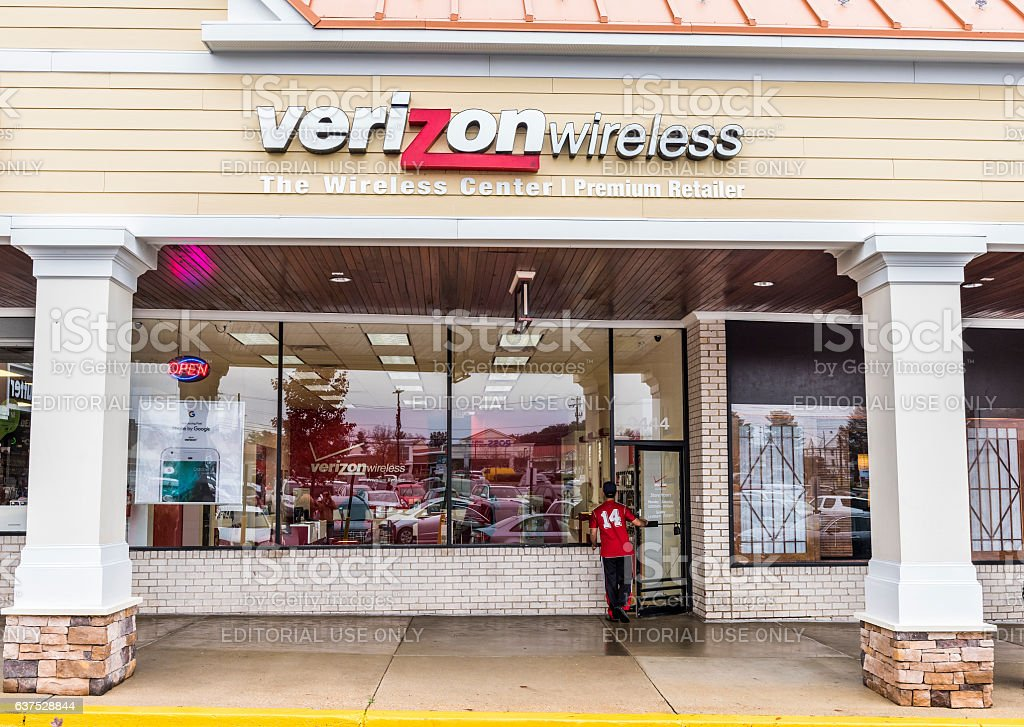 Verizon wireless center store facade exterior with person entering stock photo