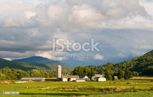 488912426istockphoto vermont dairy farm under cloudy sky horizontal 146879538