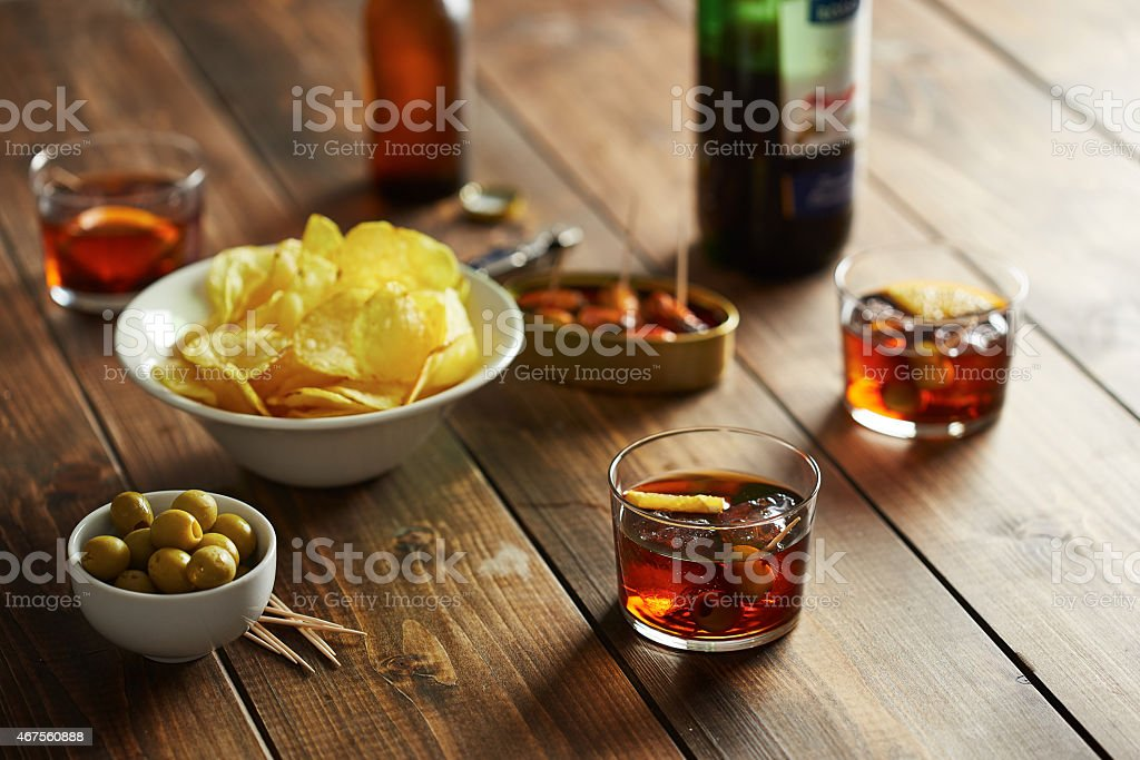 Vermouth glasses with appetizers stock photo