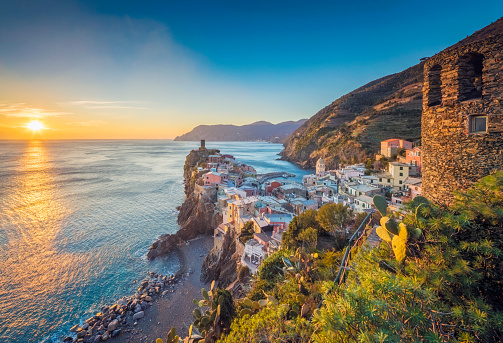Photo of colorful fishing houses the fishing port of Vernazza at sunset, Cinque Terre World Heritage National Park, Ligurian Riviera, Italy