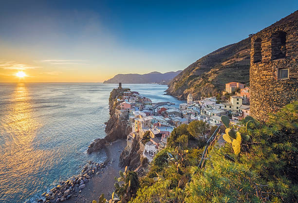 Vernazza at sunset, Cinque Terre National Park, Ligurian Riviera, Italy Photo of colorful fishing houses the fishing port of Vernazza at sunset, Cinque Terre World Heritage National Park, Ligurian Riviera, Italy mediterranean sea stock pictures, royalty-free photos & images
