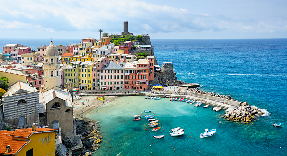 Vernazza is one of the five towns that make up the Cinque Terre region in Italy. Composite photo