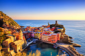 Vernazza village, aerial view on red sunset, Seascape in Five lands, Cinque Terre National Park, Liguria Italy Europe. Long Exposure.