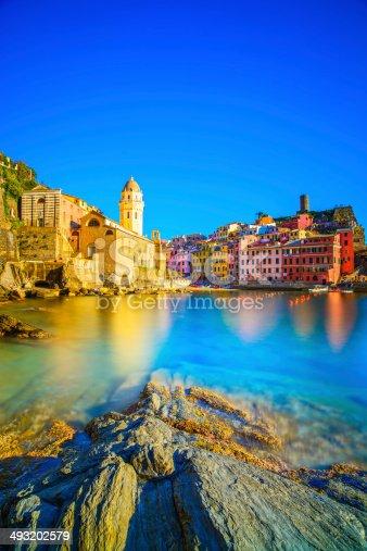 istock Vernazza village, church, rocks and sea harbor on sunset. Cinque 493202579