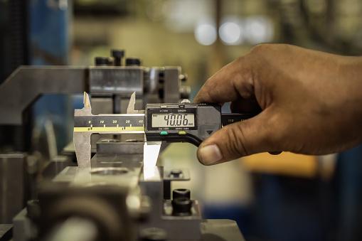 istock Vernier caliper measure part of jig fixture in factory 809506912