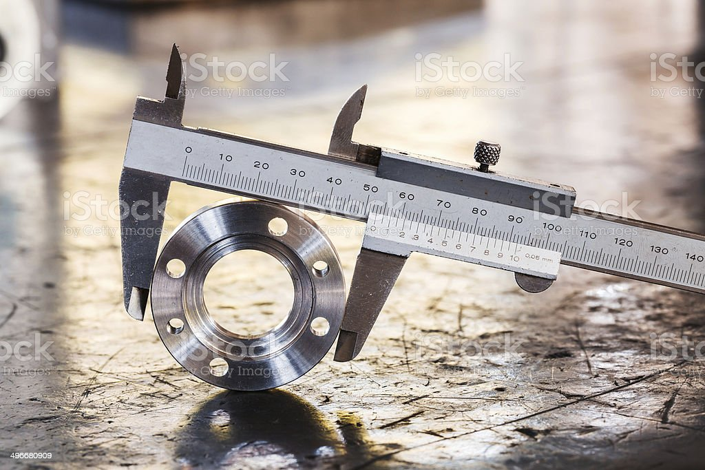 vernier caliper measurement Close up vernier caliper measure diameter of stainless steel flange Accuracy Stock Photo