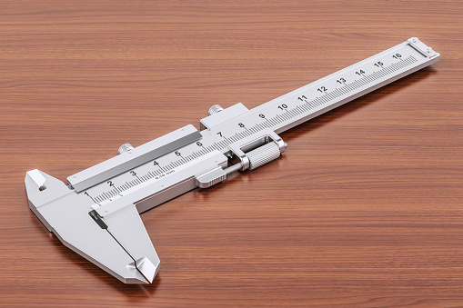 istock Vernier caliper on the wooden table. 3D rendering 900699866