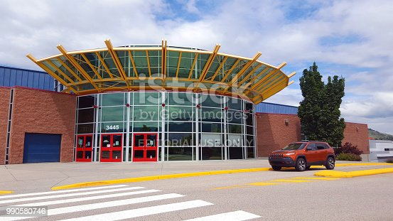 Vernon,British Columbia,Canada- June 23,2018: Exterior view of modern architecture Sports Center entrance . SUV parked outside.