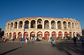 Verona, Italy - August 12, 2017: People around at Piazza Bra in front of the famous Arena di Verona on a sunny summer afternoon.