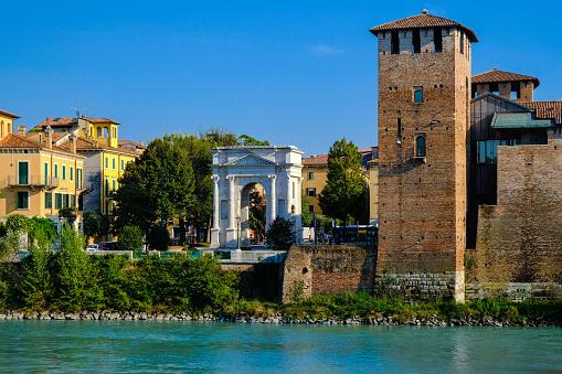 Verona, Italy: View on embankment of Adige river with ancient roman arch Arco dei Gavi