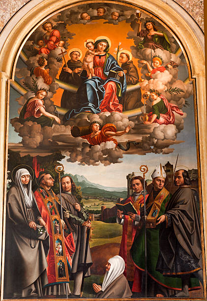 Verona - Madonna and saints in San Bernardiono church Verona - Virgin Mary with the st. Anthione and st. Francis and other saints. Paint by Paolo Morando 1522 in San Bernardino church on January 2,. 2013 in Verona, Italy. st. anthony of padua stock pictures, royalty-free photos & images