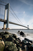 Suspension bridge Verrazzano-Narrows New York City Brooklyn coastline water rocky traffic sunrise Staten Island Wadsworth fort borough urban
