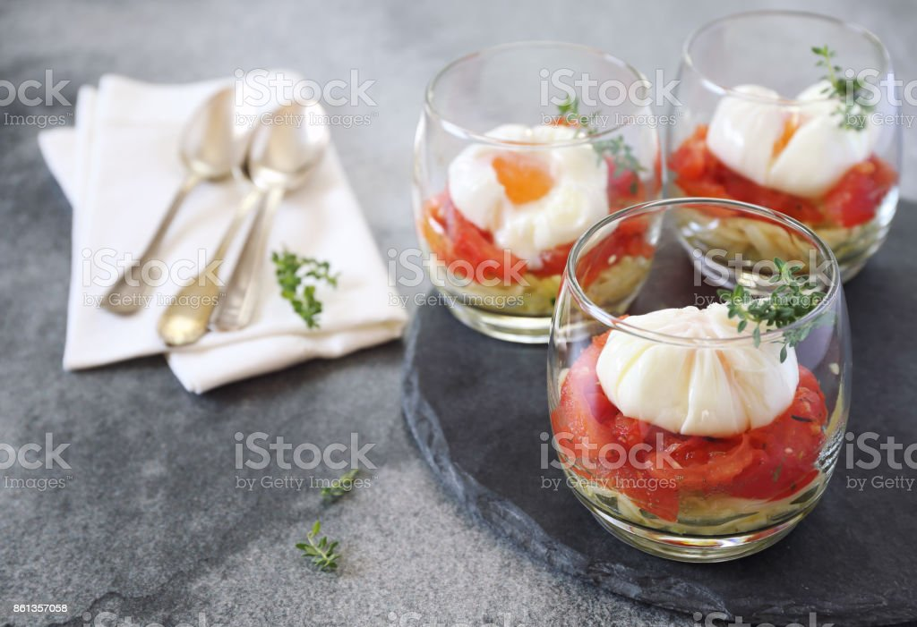 Verrines breakfast: poached eggs, tomatoes and zucchini stock photo