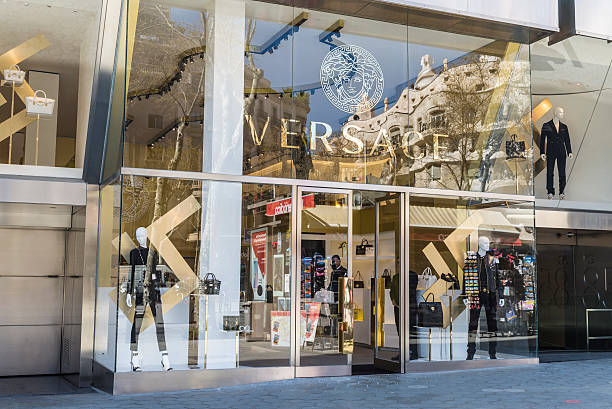 Versace store, Barcelona Barcelona, Spain - March 27, 2015: Versace shop located on Passeig de Gracia, one of the most expensive streets in Europe. gracia baur stock pictures, royalty-free photos & images