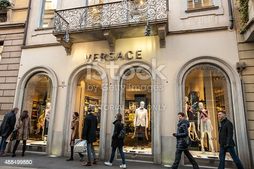 Milan, Italy  - December 22, 2014: Versace Store on Via Monte Napoleone, Milan. People walking on famous shopping street