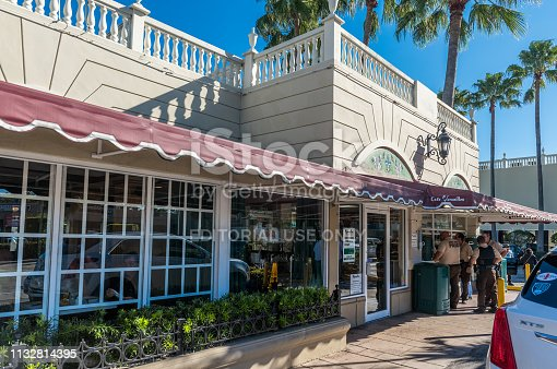 Miami, Florida, USA - February 28, 2019: Sunny morning at Cuban restaurant Versailles. Cuban cuisine establishment with cafeteria, restaurant, and bakery, is located on Calle Ocho in Little Havana, Miami.