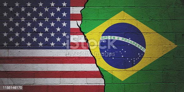 Cracked brick wall painted with an American flag on the left and an Brazilian flag on the right.