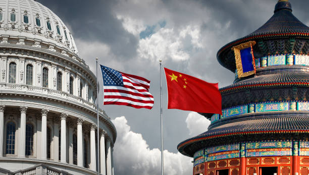 USA versus China US and Chinese national symbols: The Capitol in Washington DC and Temple of Heaven in Beijing with national flags trade war stock pictures, royalty-free photos & images