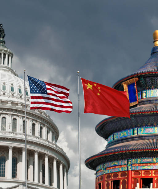 USA versus China US and Chinese national symbols: The Capitol in Washington DC and Temple of Heaven in Beijing with national flags american culture stock pictures, royalty-free photos & images