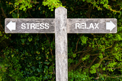 Stress Versus Relax Directional Signs Stock Photo - Download Image Now