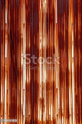 istock Vertical abstract red rusted galvanized corrugated iron for background - old and rusty iron roof of a building for background - NSW Australia 1133157625