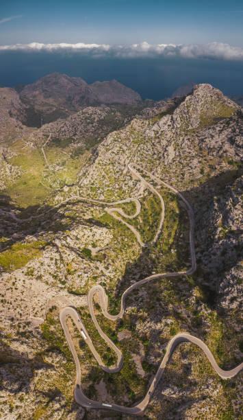 Vertical aerial photo of mountain serpentine road. Mallorca, Spain. stock photo