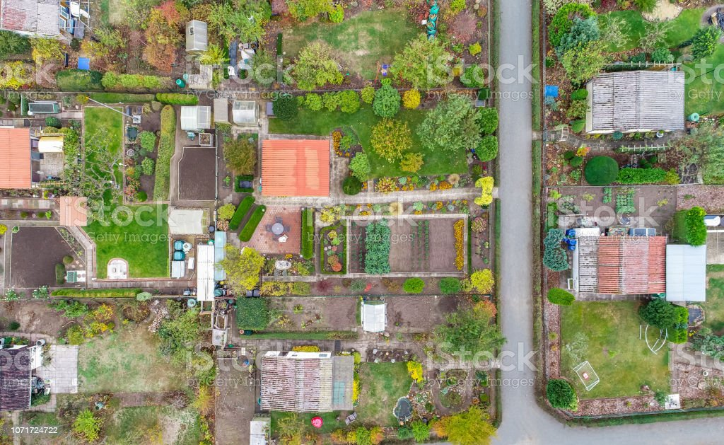 Vertical Aerial View Of An Allotment Garden With Huts Paths And