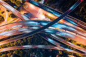 istock vertical aerial view of city overpass by drone at night 1254584200