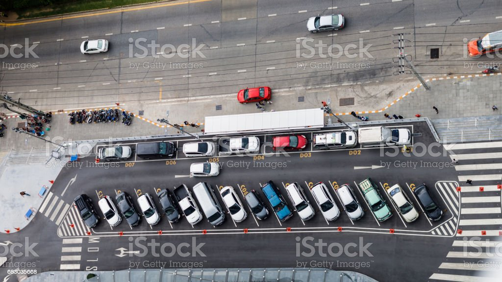 vertical aerial view over car parking place near the road foto de stock royalty-free