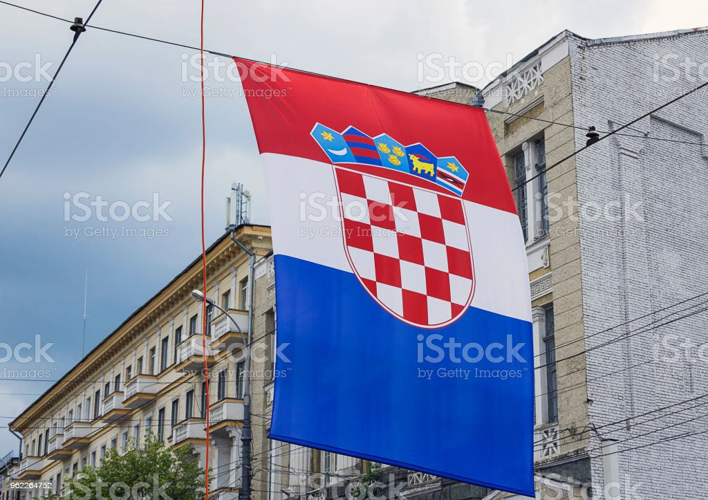 Vertical banner in colors of the Flag and coat of arms of Croatia on old street background. - foto stock