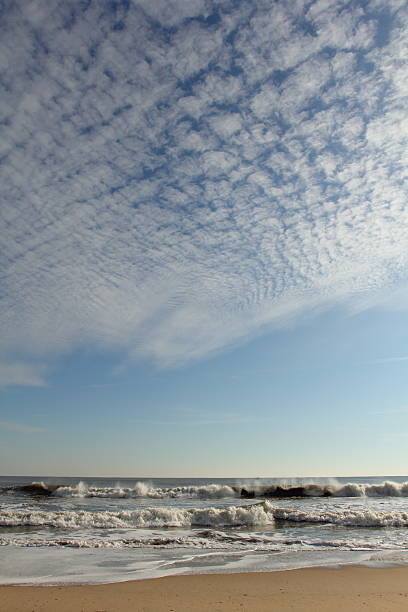 Vertical Beach Landscape Vertical Beach Landscape.  Shot taken at Ocean City, Maryland in December, 2011. altocumulus stock pictures, royalty-free photos & images