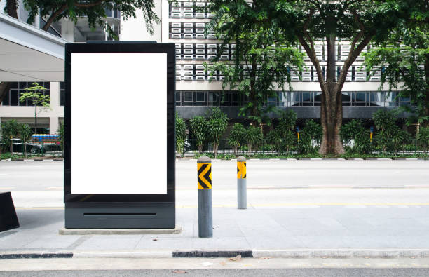 vertical blank  billboard at bus stop outdoor advertise on street mock up. the poster on the road with motion moving bus - composizione verticale foto e immagini stock