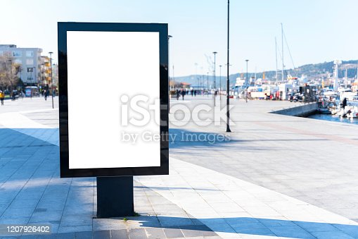 932815522 istock photo Vertical blank billboard on the city street 1207926402