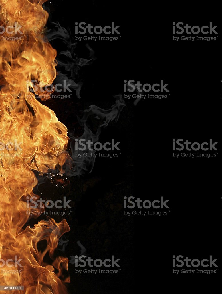 Vertical blazing flames on a black background stock photo