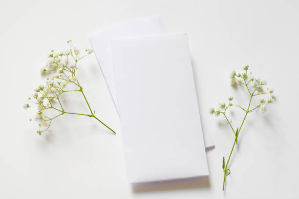 vertical botanical stationery mock up decorated by delicate flowers and gold ribbon stock photo