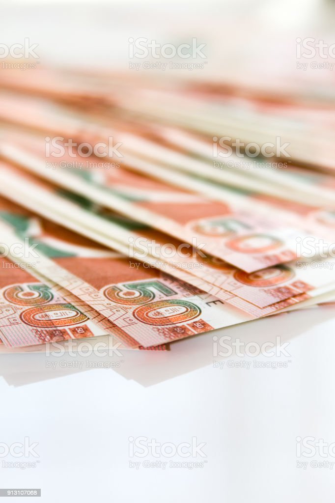 Vertical close-up macro of 50 soles peruvian banknotes placed in a fan shape on white background stock photo