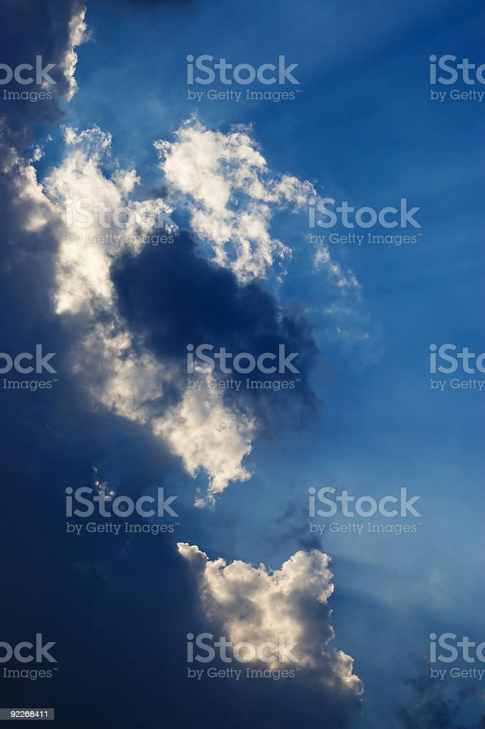 vertical clouds and light rays royalty-free stock photo