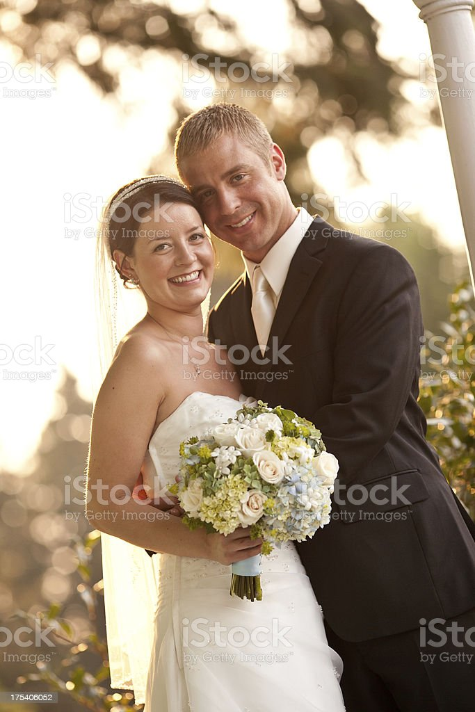Vertical Color Newlyweds On Country House Porch Wooded Background Smiling stock photo