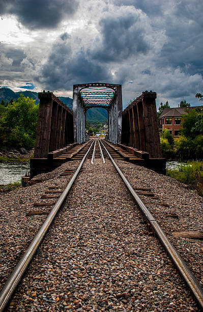 Vertical Durango Colorado Bridge HDR Animas River Crossing Vertical Durango Colorado Bridge HDR Animas River Crossing before the EPA Spilled Millions of Gallons of toxic waste from the Silverton Mine into the Animas River. This was taken in 2010 when the Animas river was clean and fresh water , the Clouds were spectacular and dramatic clouds. The Abandoned Rusty Bridge makes a dramatic perspective diminishing vantage point  animas river stock pictures, royalty-free photos & images