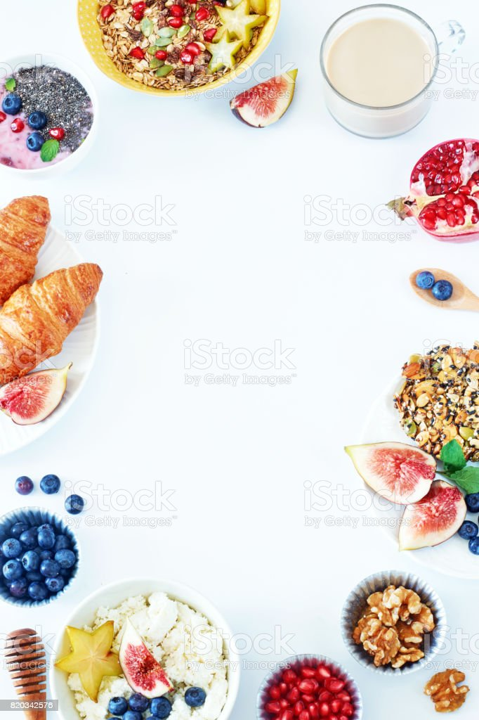 Vertical food frame of breakfast dishes over white background with a copy space. stock photo