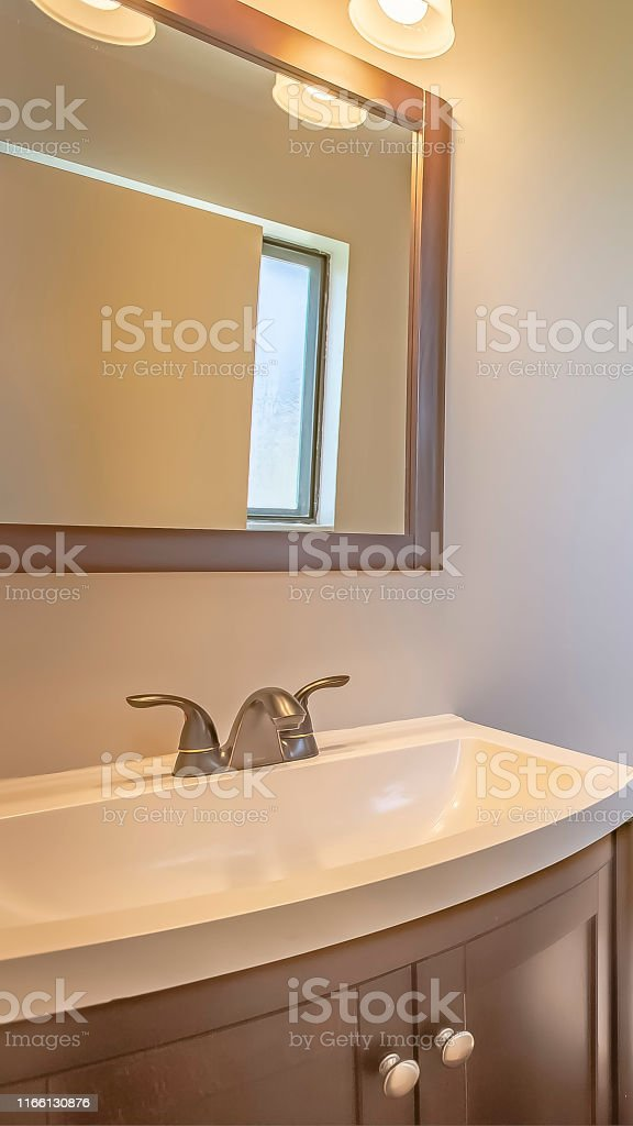Vertical frame Bathroom interior of a home with toilet sink and...