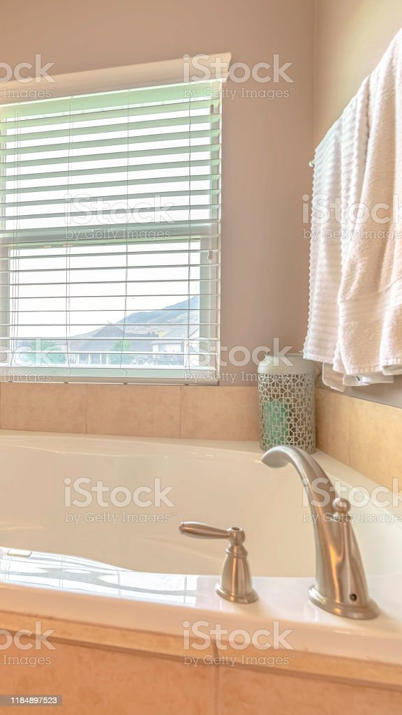 Vertical Frame Modern Spa Bath With Warm Window Lighting Stock Photo Download Image Now Istock