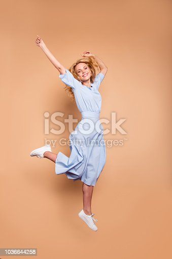 Vertical full length body size studio photo portrait of cute cool free fresh charming pretty attractive lady in light blue clothing feeling expressing happiness isolated bright pastel soft background