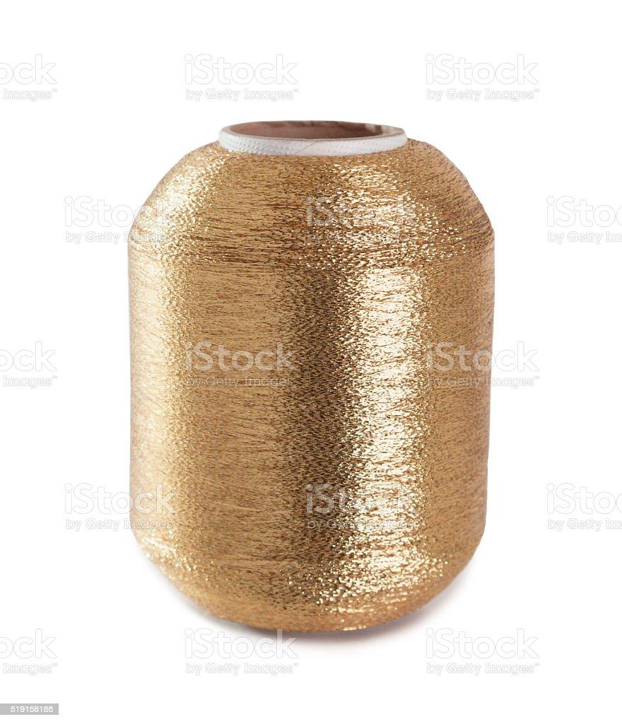 Vertical gold bobbin. stock photo