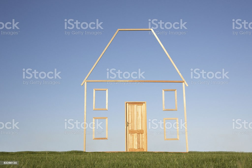 Vertical house outline in field stock photo