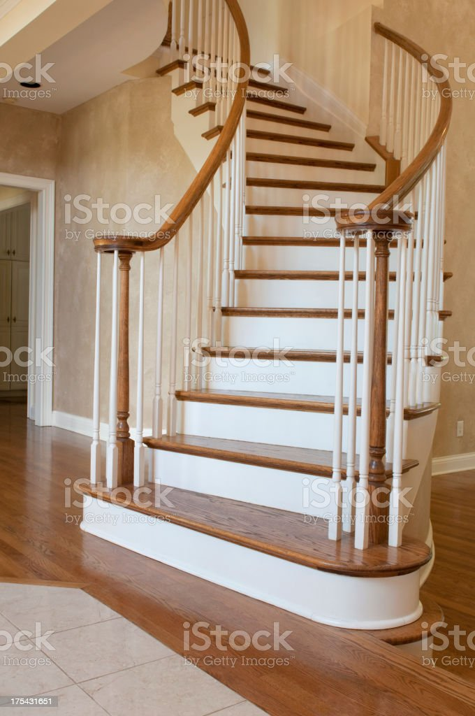 Vertical image of a curved entryway staircase royalty-free stock photo