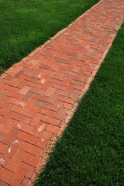 vertical image of brick path stock photo
