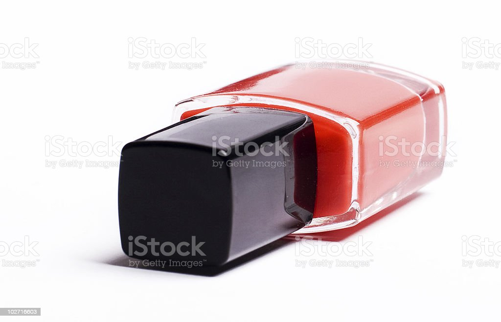 vertical image of red nail polish on a white background royalty-free stock photo