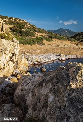 istock Vertical landscape with rock formation and blue sea on the Northern Cyprus. 1129333044