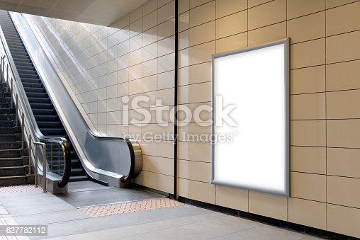 istock Vertical light box poster mockup in metro station. 627782112